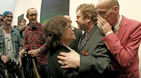 Who doesn't like gossip? John Waters dishing the dirt with Ingrid Sischy and Sir Elton John at pre-Oscar Gagosian opening. Photo by Eric Minh Swenson
