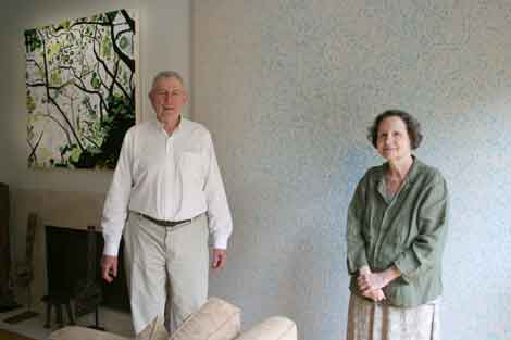 The Schorr's in their Marina Del Rey house with a Laura Owens painting to the left over the fireplace. Photo by Peter Bartlett