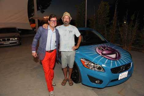 Jamie Brooks and artist Kenny Scharf in front of Brooks' newly painted car