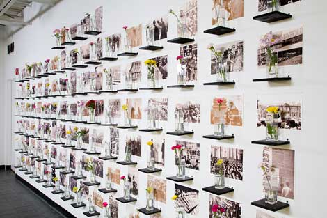 Dread Scott, Let 100 Flowers Blossom, Let 100 Schools of Thought Contend (2007/2014), Inkjet prints, wood, flowers, Courtesy of the artist.