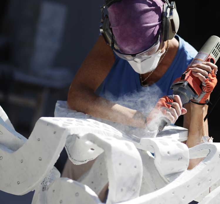 Elizabeth Turk at work on her sculpture. Photo by Eric Stoner.