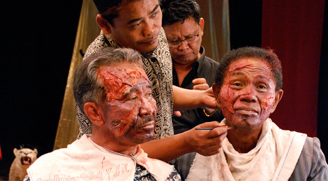 Preparing for a reenactment scene from Drafthouse Film's   documentary, The Act Of Killing.
