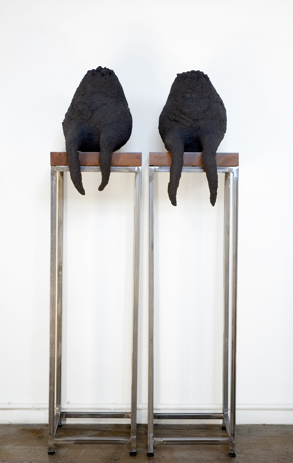 "Camilla Taylor, It Wasn't Until Then, 2014, cartonnage, walnut, welded steel, 52 x 13 12"" (individually), photo by Mike Reynolds."