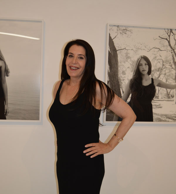 Laura London with her art at Chimento Contemporary