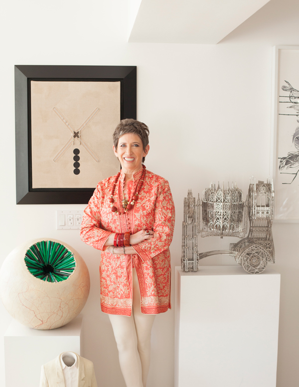 "Beth Rudin DeWoody with works from her collection (top to bottom): Donald Moffett painting, Wim Delvoye ""Concrete Mixer,"" Tim Hawkinson sculpture, Erwin Wurm sculpture, photograph by Firooz Zahedi."
