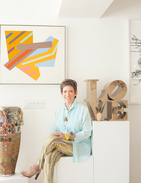 Beth Rudin DeWoody with works from her collection: drum by Bruce Conner, art by Frank Stella and Robert Indiana sculpture, photograph by Firooz Zahedi