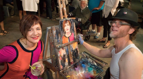 Tulsa Kinney with Alex Schaefer painting her live portrait