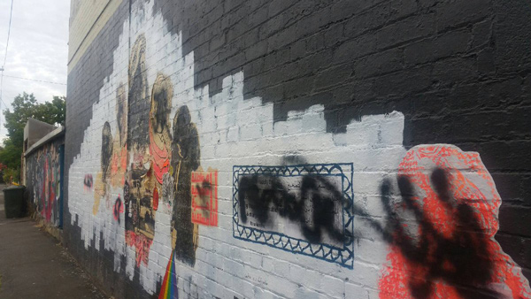 Defaced mural by Ms Saffaa; photo credit Twitter/Ms Saffaa.