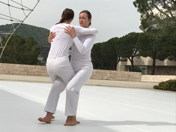 dancer hug The Trisha Brown Dance Company's In Plain Site