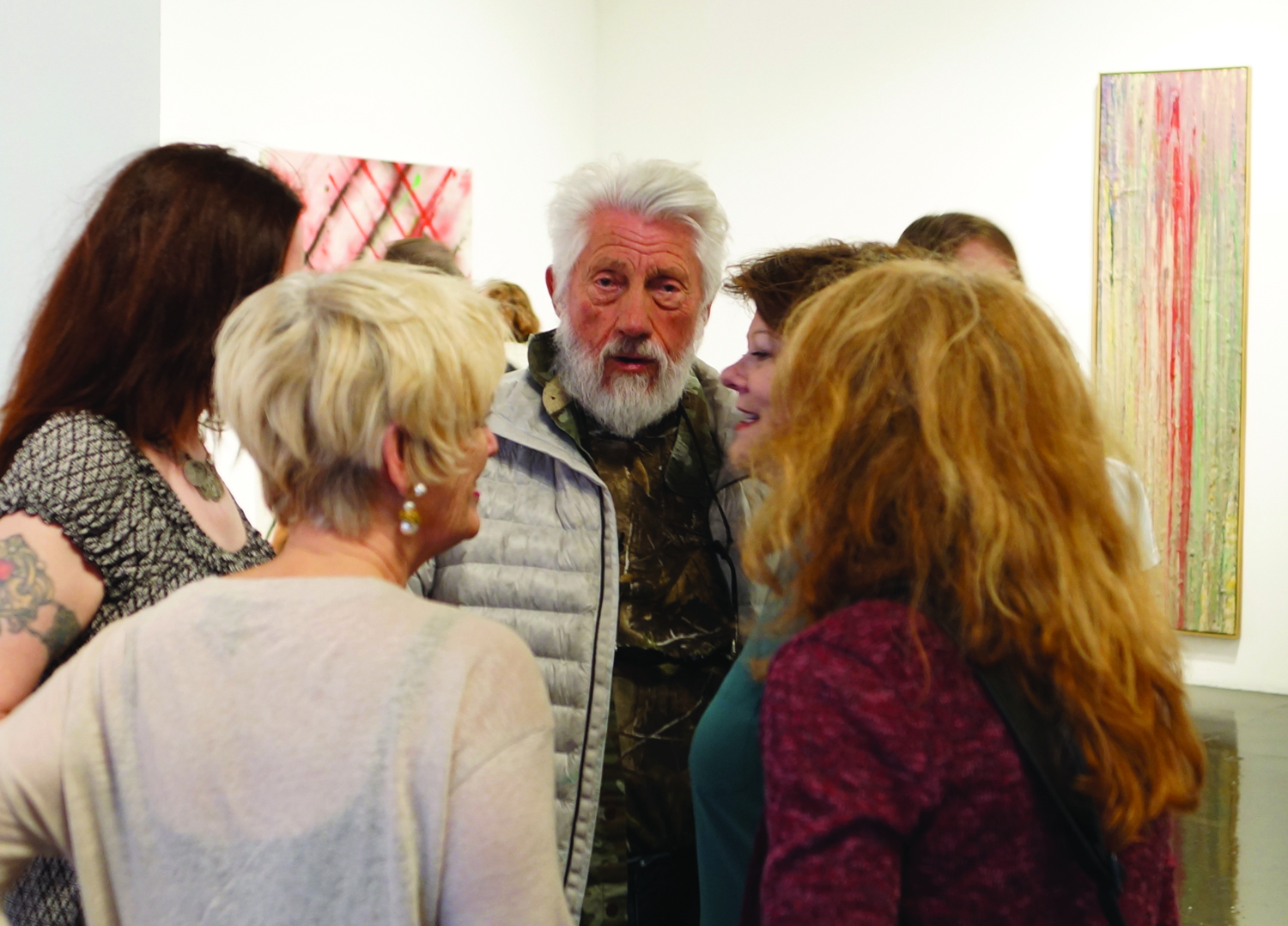 Ed Moses at his art opening at William Turner gallery, surrounded by admirers. Photo by Lynda Burdick.