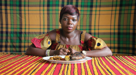 Zina Saro-Wiwa, Precious Eats Boli and Fish with Oil Bean, Table Manners: Season 2, (2019), courtesy of the artist and Fowler Museum.