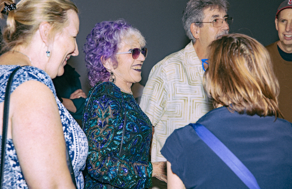 Judy Chicago surrounded by admirers at the opening of her exhibition at Jeffrey Deitch, Los Angeles. © 2019 Ozeylah Smyth